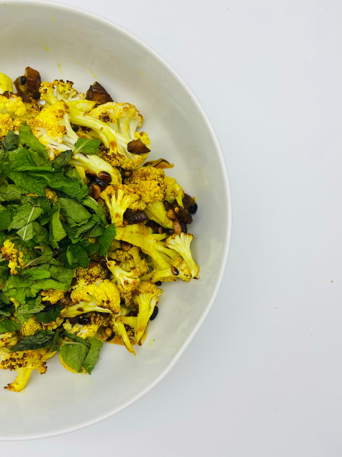 TURMERIC ROASTED CAULIFLOWER WITH DATES AND PINE NUTS